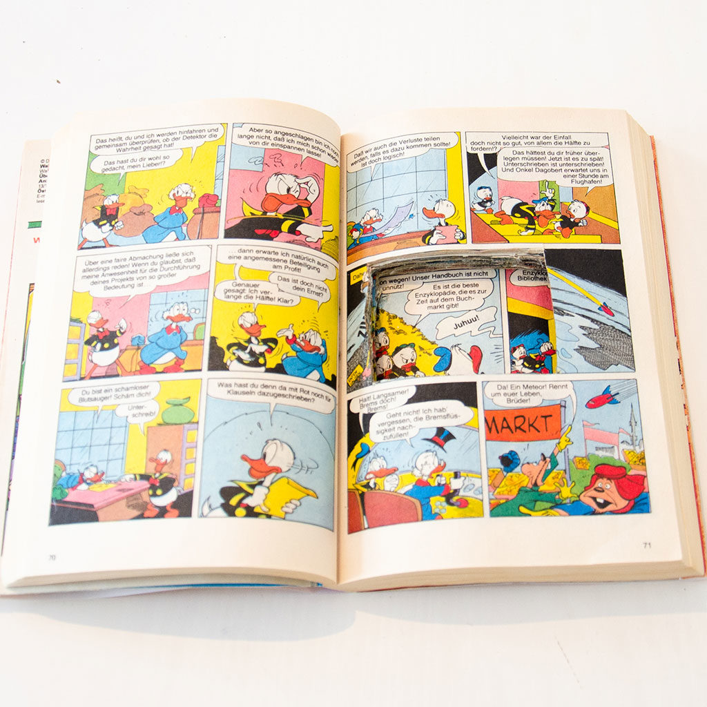 Je mehr Seiten Sie zerschneiden, desto tiefer wird das Buchversteck.