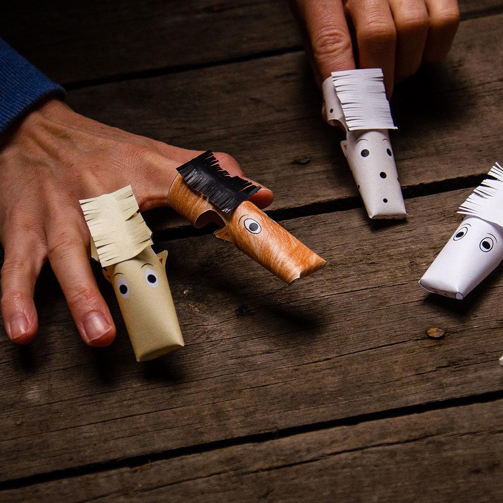 Fingerpuppen basteln: An die Finger, fertig, spielen.